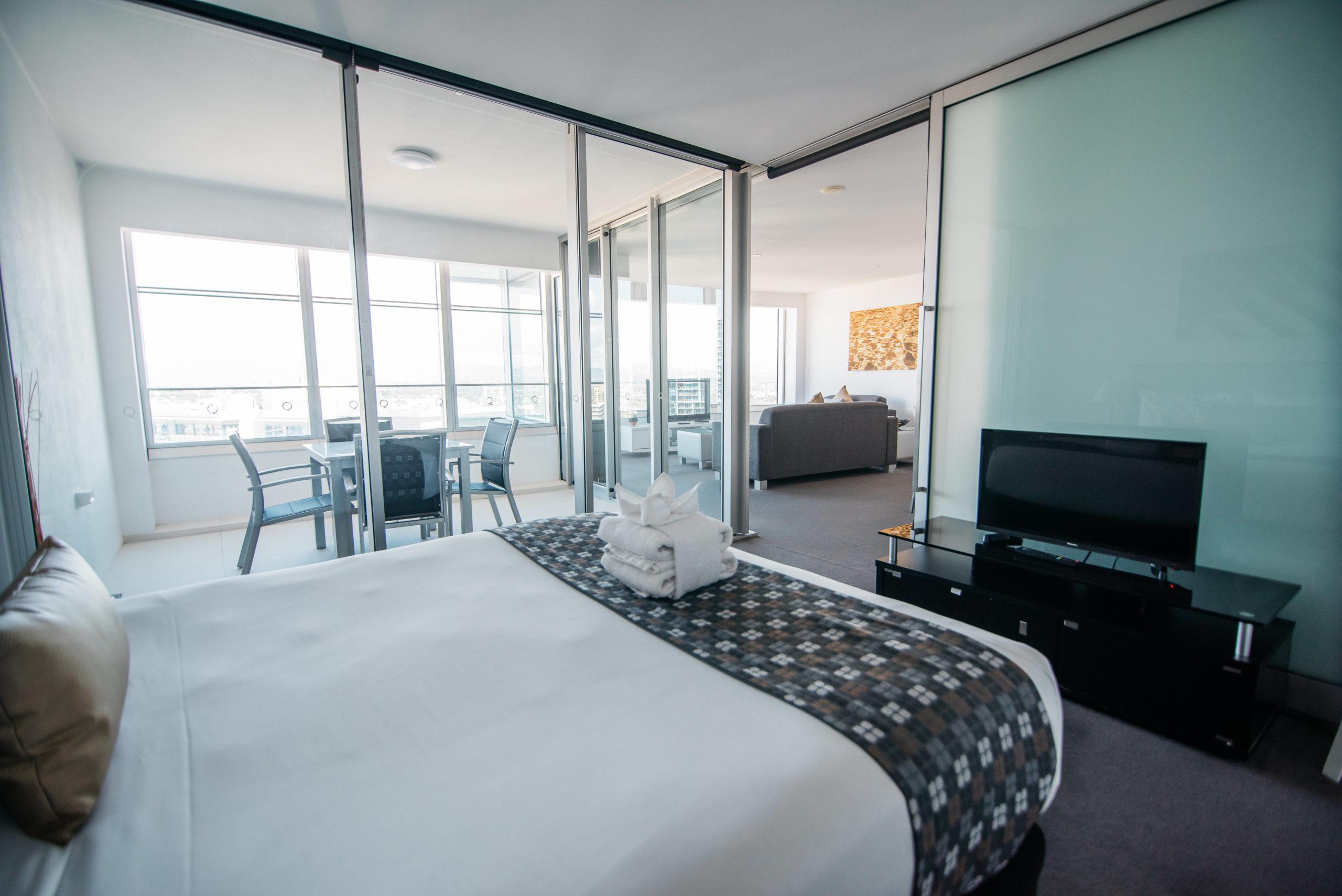 Q1 Resort & Spa One Bedroom Family Spa Apartment | Master Bedroom & Balcony